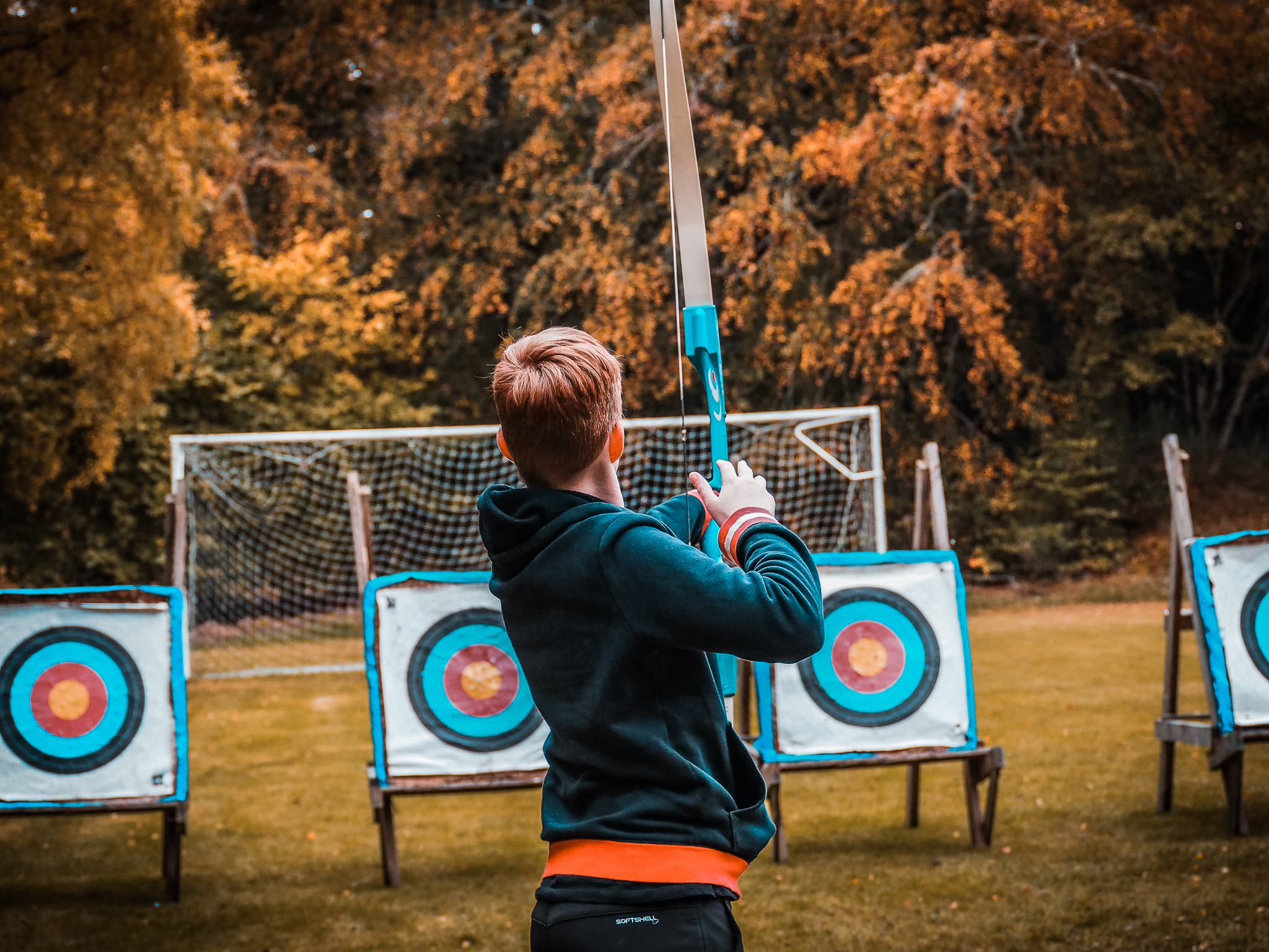 Child practices his skill at archery