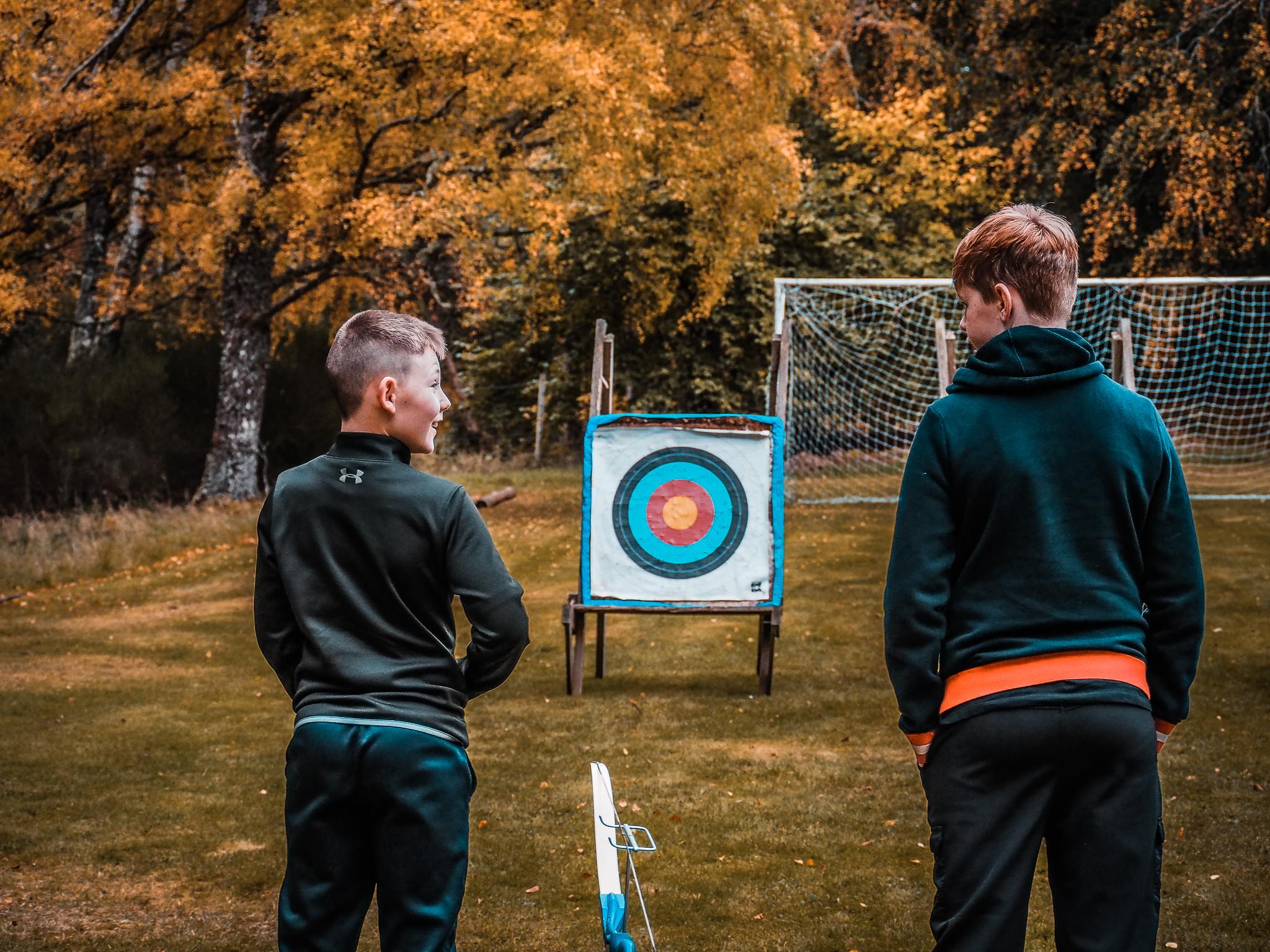 Children enjoying archery