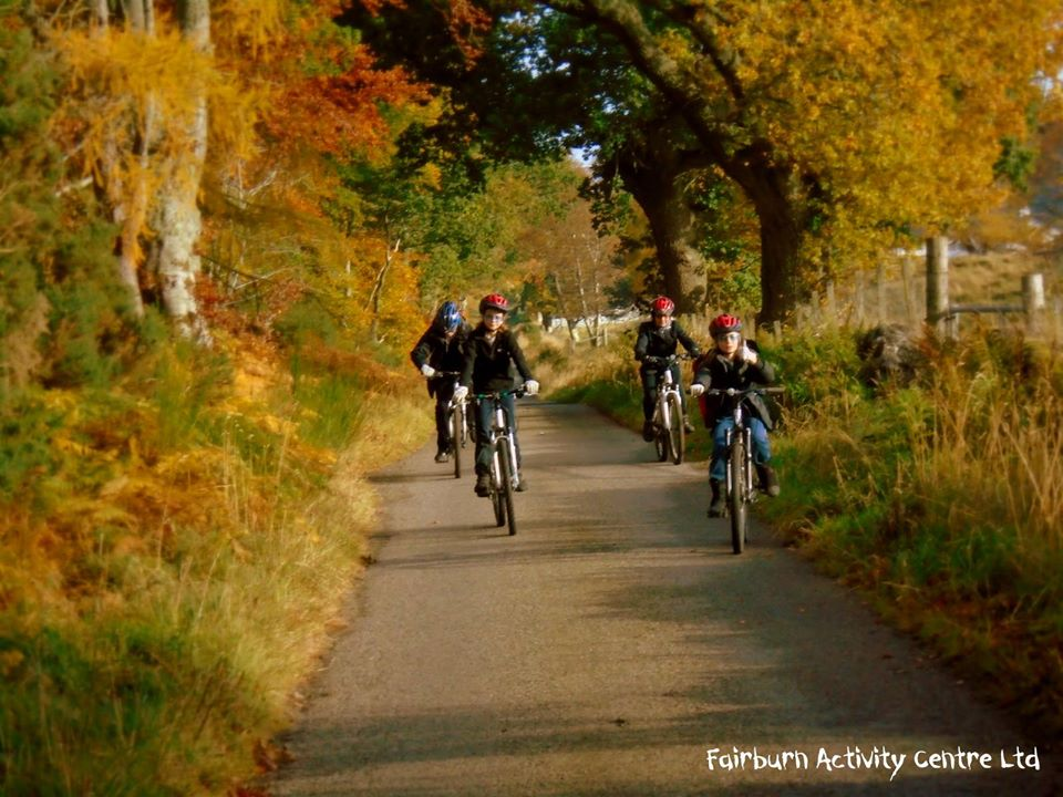 mountain bikers enjoying a ride through Contin Forest.